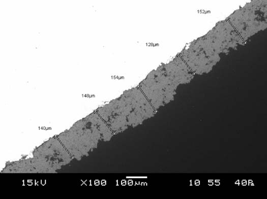 Figure 2a: Cross section of a 130 micron thick Acusure hydroxyapatite coating.
